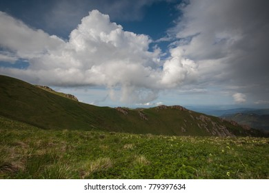 The formation and movement of clouds over the summer slopes of Adygea Bolshoy Thach and the Caucasus Mountains