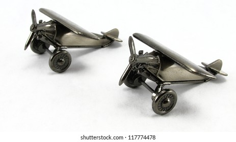 Formation of pewter toy airplanes illustrating the wingman concept.  Focus is set to wingman aircraft to emphasize conccept importance.
