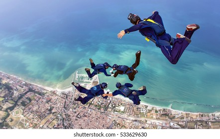 Formation Skydivers during training over sea