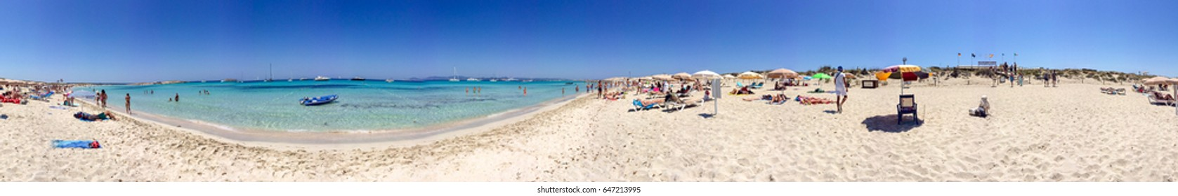 FORMENTERA, SPAIN - JUNE 2015: Tourists enjoy wonderful island beach, panoramic view. Formentera is a famous tourist destination in Spain.