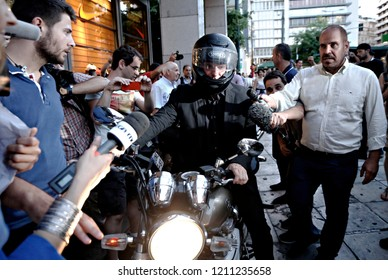 Former Greek Finance Minister Yanis Varoufakis (C) is surrounded by the media as he leaves the Finance Ministry in Athens, Greece July 6, 2015.