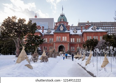 Former Hokkaido Government Office Building, Sapporo, Japan - February, 2018 : Unidentified pedestrians walk in front of Former Sapporo Government Office Building in winter with snow and leafless trees