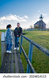 The former island Schokland. couple man and woman visit the former Island Schokland, The former island of Schokland was the first UNESCO World Heritage Site in the Netherlands. Holland