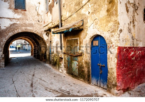 In the former Jewish quarter of Mellah in Essaouira, Morocco, the doors of dilapidated buildings are condemned