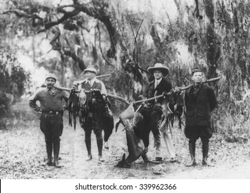 Former President Calvin Coolidge and fellow hunters display their trophies, April 1929. Coolidge was on a vacation hunting trip in the wilds of Sepelo Island, Georgia.