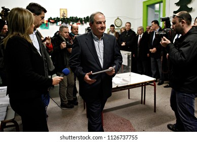 Former Prime Minister Costas Karamanlis  casts his vote for the Greek legislative election at a polling station in Thessaloniki, Greece on Jan. 25, 2015