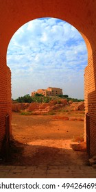 Former Saddam Hussein Palace in Babylon, view through Babylonian ruins arch , Iraq