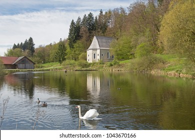 The former Sanctuary of St. Sebald in Egling is beautifully situated on a pond west of Egling