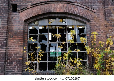 Former shipyard areas - abandoned destroyed hall with broken window glass. The Imperial Shipyard Trail,  Gdansk Shipyard, Poland