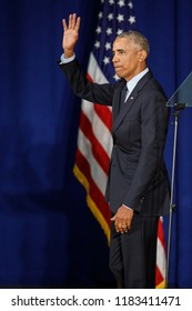 Former U.S. President Barack Obama leaves the stage after slaming President Trump and republicans at the University of Illinois Urbana-Champaign in Urbana, Illinois, September 7, 2018.