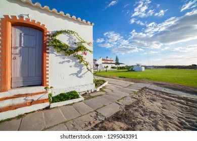 Former whitewashed fishermen huts, converted into tourist facilities at Praia do Barril beach, Tavira, Algarve, Portugal