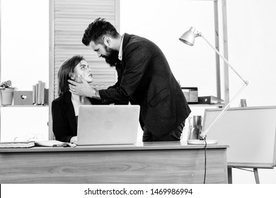 Forming close bonds with workmate. Workplace affair. Boss and secretary having sweet affair. Love affair of bearded man and sexy woman in office. Couple in love conducting affair at work.