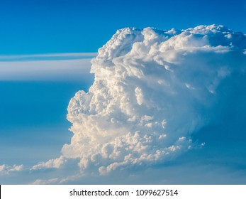 Forming cumulonimbus clouds seen from the airplane
