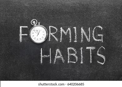 forming habits phrase handwritten on chalkboard with vintage precise stopwatch used instead of O