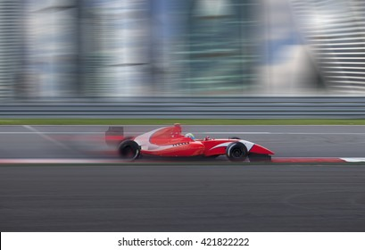 Formula 2.0 race car racing at high speed with motion blur on the background of the city in the day