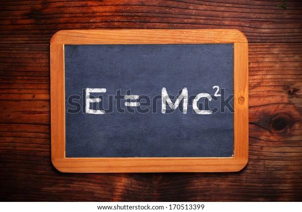 formula of theory of relativity written on the blackboard