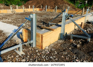Formwork foundation garage. External construction. Freshly concreted foundation. With wooden frame mounted before concreting_02