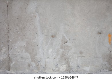 Formwork traces on concrete. Repair and construction or constructing. Concrete background. Grey color. Cement texture. Poor quality curve wall. Flaws, defects and cracks in the wall.