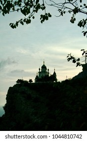 Foros church in evening light. Crimea, Ukraine. Frame from brabches silhouettes and a cape.