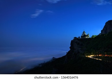 FOROS, CRIMEA - Evening view from observation platform at Old Sevastopol Highway on the Church of Christ's Resurrection rising on the high Red Cliff over covered with clouds