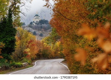 Foros, Crimea, Russia- October 18, 2019: Foros Church (Church of the Resurrection of Christ in foros). The road to the temple in autumn. Very beautiful colorful autumn landscape in the mountains.