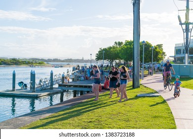 Forster, NSW, Australia-April 20, 2019: People enjoying the sunny weather on the waterside in the city of Forster, a coastal town in the Great Lakes region of New South Wales, Australia