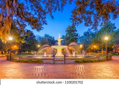 Forsyth Park, Savannah, Georgia, USA fountain at twilight.