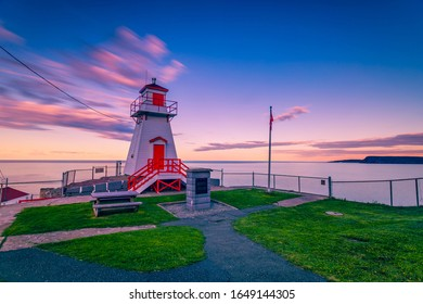 Fort Amherst Lighthouse at St John, Newfoundland, Canada with burned sunset sky as background