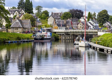 Fort Augustus, United Kingdom - August 19, 2014: The Caledonian canal at the Loch Ness lake. The Canal connects the Scottish east coast at Inverness with the west coast at Corpach near Fort William