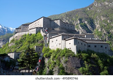 Fort Bard, Aosta Valley, Italy (Italian: Forte di Bard). Is a fortified complex built in the 19th century by the House of Savoy on a rocky prominence above Bard, a town and comune in the Aosta Valley.