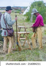 FORT BRIDGER , WYOMING - AUG 30 :Unidentified participants in the Fort Bridger Rendezvous held in Fort Bridger Wyoming on August 30 2014. Rendezvous is a mountain man celebration of the Fur Trade Era