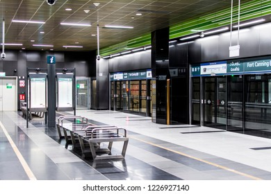 FORT CANNING, SINGAPORE - NOV 3, 2018: Downtown line platform of Fort Canning MRT Station with metallic benches and route maps.