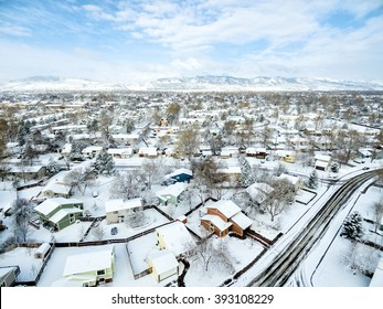 Fort Collins cityscape - aerial  view of typical residential neighborhood along Front Range of Rocky Mountains in Colorado, late winter  or early spring scenery with snow.