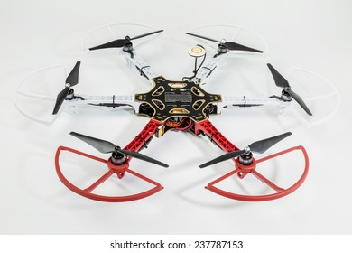 FORT COLLINS, CO, USA, December 13,  2014:  Radio controlled DJI  F550 Flame Wheel  hexacopter drone with propeller guards  on a white background. This drone is assembled from  a kit,
