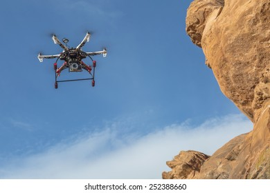 FORT COLLINS, CO, USA, February 12,  2015:  F550 Flame Wheel  hexacopter drone is  flying with a camera along sandstone cliff.