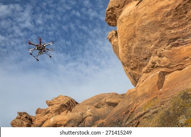 FORT COLLINS, CO, USA, February 12,  2015:  DJI F550 Flame Wheel  hexacopter drone is  flying with a camera along sandstone cliff.