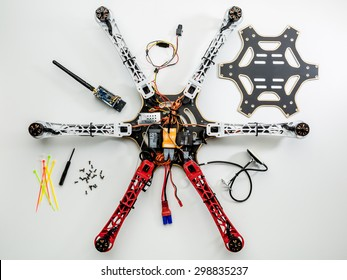 FORT COLLINS, CO, USA, JULY 20,  2015:  Assembling a hexacopter drone (DJI F550 Flame Wheel). all parts are in place except video transmitter and upper cover board.