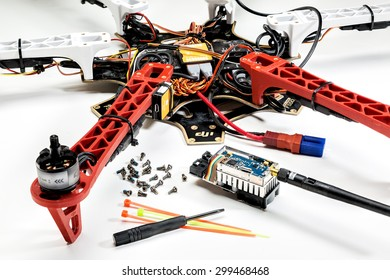 FORT COLLINS, CO, USA, JULY 20,  2015:  Disassembling and repairing a hexacopter drone (DJI F550 Flame Wheel) with video transmitter, screwdriver and screws in front.