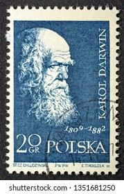 Fort Collins, CO, USA - March 19, 2019: Charles Darwin, English naturalist, geologist and biologist,  portrait on a vintage, canceled post stamp from Poland (circa 1959).