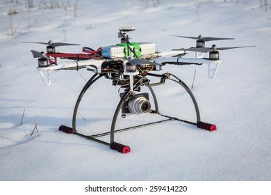 FORT COLLINS, CO, USA, March 9,  2015:  DJI F550 Flame Wheel  hexacopter drone just landed on a snow covered field.