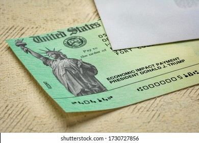 Fort Collins, CO, USA - May 13, 2020: United States Treasury Economic Impact Payment stimulus check for Coronavirus COVID-19 relief.