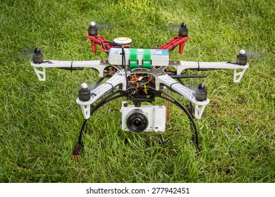 FORT COLLINS, CO, USA, May 14, 2015:  DJI  F550 Flame Wheel  hexacopter drone with Sony A6000 camera taking off from a backyard lawn.