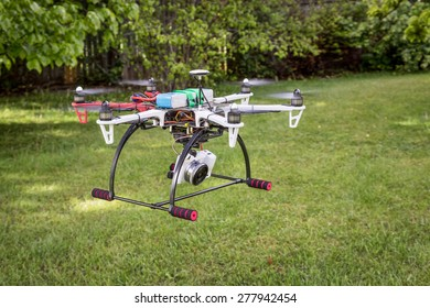 FORT COLLINS, CO, USA, May 14, 2015:  DJI  F550 Flame Wheel hexacopter drone with Sony A6000 camera flying over backyard lawn