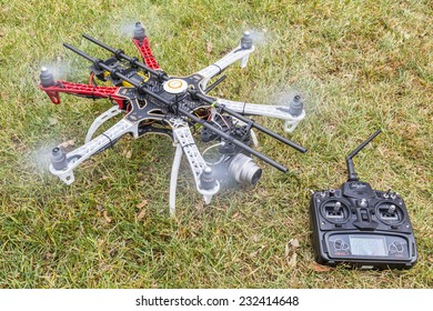 FORT COLLINS, CO, USA, November 22,  2014: DJI  F550 Flame Wheel  hexacopter drone, assembled from a kit, ready for aerial photography mission, shown with spinning rotors and Devo 7 transmiter.