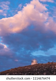 Fort Davis, TX - March 12 2018: The domes of McDonald Observatory shine in the evening sunlight.