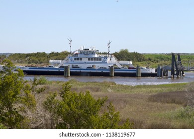 FORT FISHER , NORTH CAROLINA, USA - APRIL 20, 2018: The Southport - Fort Fisher Ferry boat, a year-round vehicle and passenger ferry that runs between between Southport and Fort Fisher, NC