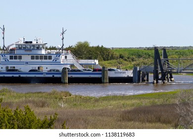 FORT FISHER , NORTH CAROLINA, USA - APRIL 20, 2018: The Southport - Fort Fisher Ferry boat docking, a year-round vehicle and passenger ferry that runs between between Southport and Fort Fisher, NC