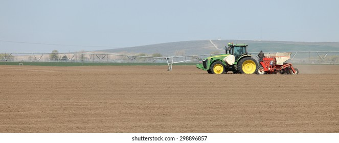 Fort Hall, Idaho, USA Apr. 17, 2015 A tractor in the field planting potatoes