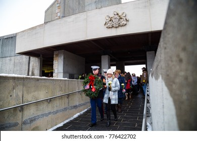 FORT INDIANTOWN GAP, PA, USA - December 16, 2017: A US Marine carries a wreath during a ceremony at the National Cemetery at the Wreaths Across America event.