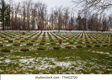 FORT INDIANTOWN GAP, PA, USA - December 16, 2017: Graves decorated with wreaths by volunteers at the National Cemetery at the Wreaths Across America event.